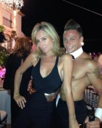 sonja-posing-with-male-dancer-on-vacation